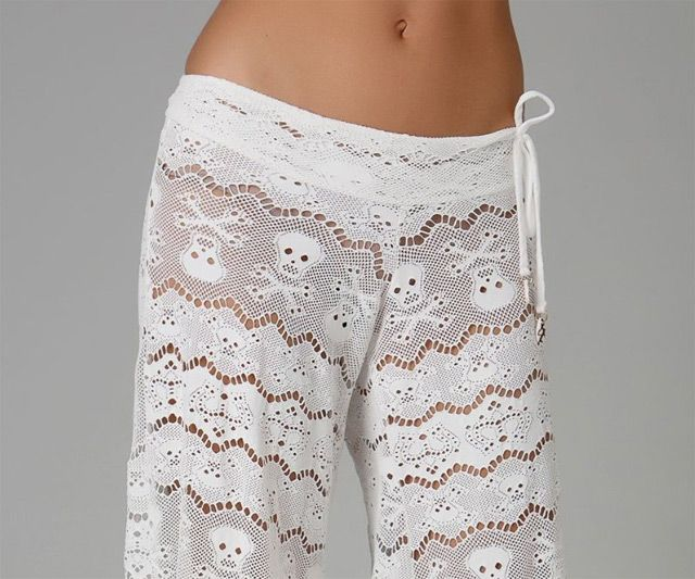 I wanna get my BFF these, but then again I see myself wearing these on the beach during my next trip.... Lace Skull Crossbones Pants | DudeIWantThat.com