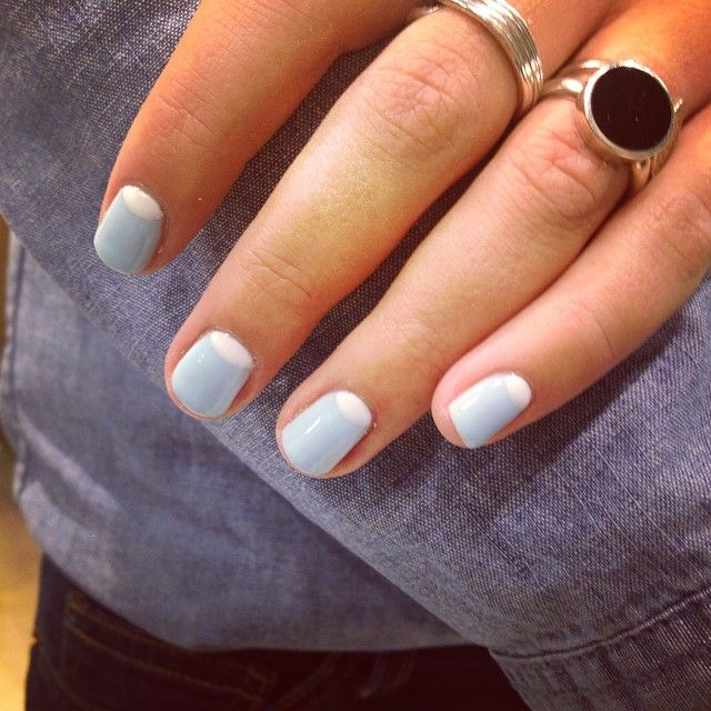 Powder blue and white half moon manicure by me with double denim and silver rings.