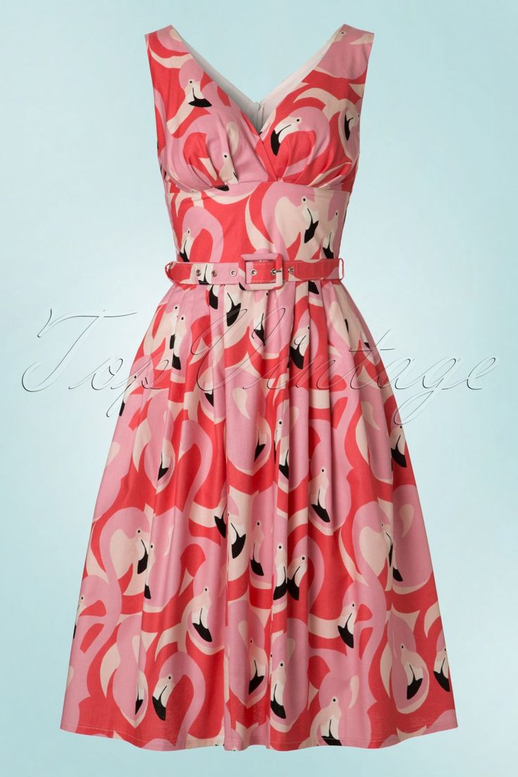 Elegant, striking and with the looks of a paradise bird! No... we're not talking about the flamingo, it's the impression you're going to leave when wearing this 50s Flamingo Swing Dress... exclusively available at TopVintage!With both feet on the ground? Not while wearing this dress ;-) This vintage inspired beauty features a stunning V-neckline with little wrap-over, pleats at the bust and a flowy skirt with box pleats creating a typical fifties silhouette, oh la la. Ma...