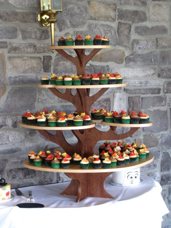 Wooden Cupcake Tree..... I made one like this for our mini cupcakes and mini pies, except mine has 3 branches not 4 =) Very easy to make.