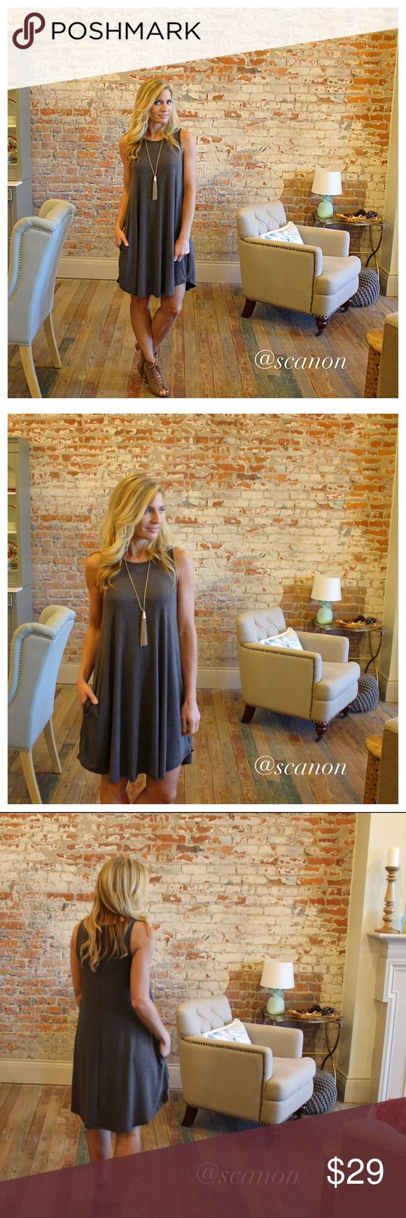 """Charcoal sleeveless swing dress with pockets Modeling size small. 67% polyester 28% rayon 5% spandex. Bust laying flat: S 15"""" M 16"""" L 17"""" XL 18"""",, length S 34"""" M 35"""" L 36"""" XL 36.5"""". Add to bundle to save when purchasing. ZN4750126 Dresses"""
