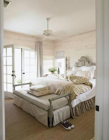 """White & Sage Bedroom """"The master bedroom has a wild sage color on the painted bench and again on the bed,"""" designer Ginger Barber says. """"I love it against crisp white linen and whitewashed walls."""""""