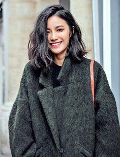green fuzzy coat