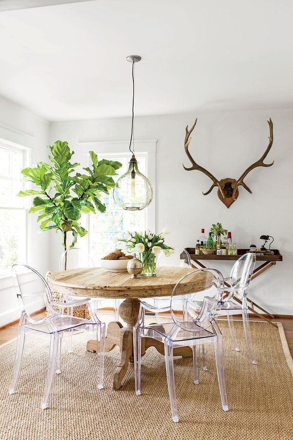 Cloud White by Benjamin Moore creates a seamless and expansive feel in this dining room - love the antlers & bar tray     Dining room: A round table eases traffic flow...