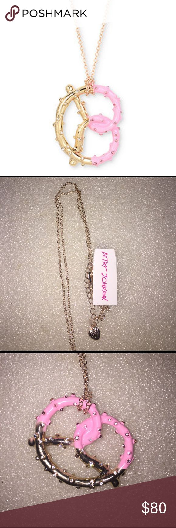 Betsey Johnson necklace Selling to buy betsey pieces I need. This is from the Marie Antoinette collection. The necklace is gold tone. The gorgeous charm is of a twisted pretzel. The gold and pink pretzel has encrusted rhinestones all around. NWT Betsey Johnson Jewelry Necklaces