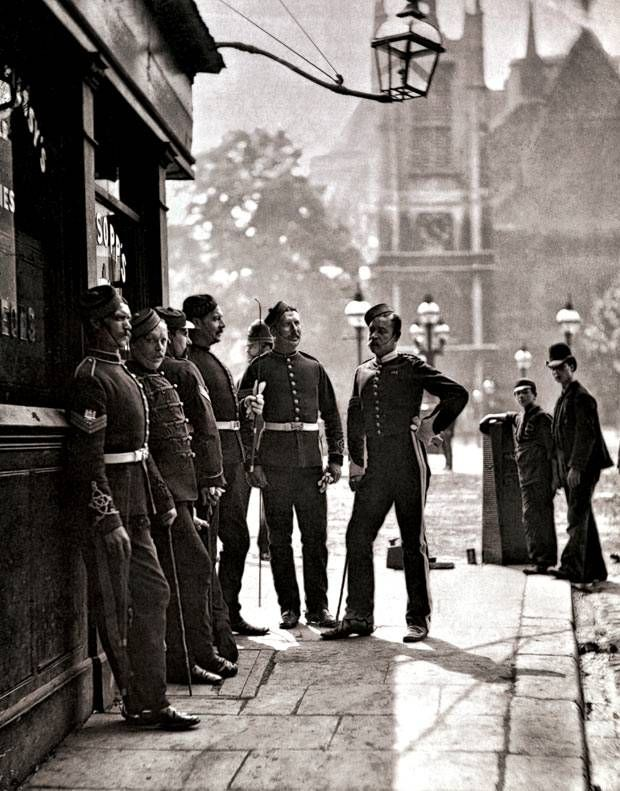 Dapper chaps: Recruiting sergeants outside the Mitre & Dove, King Street, 1 - Evening Standard. 1877