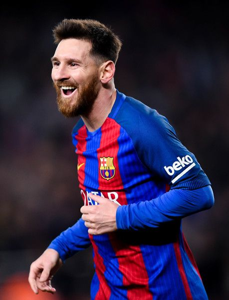 Lionel Messi of FC Barcelona celebrates after scoring his team's fourth goal during the La Liga match between FC Barcelona and RCD Espanyol at the Camp Nou stadium on December 18, 2016 in Barcelona, Catalonia.