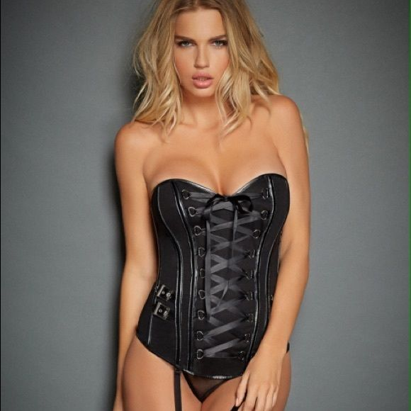 Fredericks of Hollywood Corset Fredericks of Hollywood biker corset.  Black with buckles and patent leather detail. Pair this sexy number with your favorite pair of stockings. Excellent support and lace up in fro t and back. Size Small. Frederick's of Hollywood Intimates & Sleepwear Shapewear