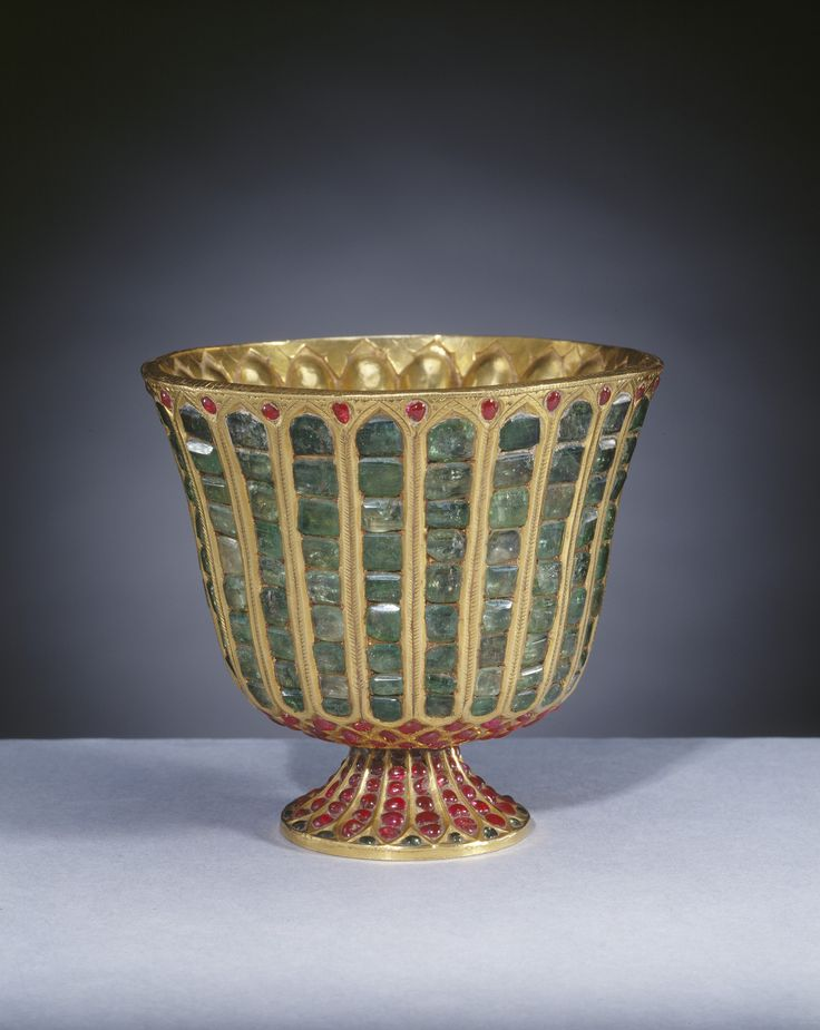 Emerald Goblet. A circular,gadrooned goblet, gilt on inside & set with vertical rows of emeralds on outside, with small cabochon rubies set into chased gold ground around lip, on shallow circular foot set all over with cabochon rubies.