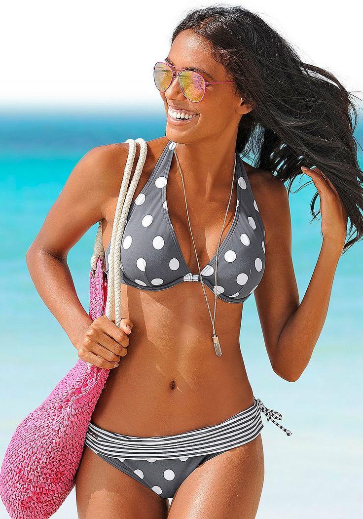 Bügel-Bikini mit modisch weißen Tupfen und gestreiftem Umschlagbund an der Hose.  Bikini-Top in Neckholder-Form, im Nacken zu binden und im Rücken zu schließen. Der trendig gestreifte Umschlagbund macht den Bikini zu einem echten Hingucker. Bikini gefüttert.   Aus 80% Polyamid, 20% Elasthan. Futter: 100% Polyamid....
