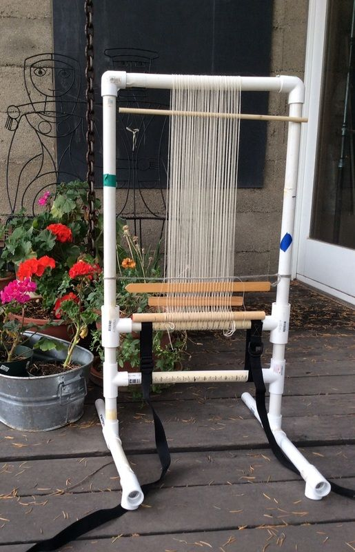 Sarah Swett's PVC loom. She has rough plans to build this loom on her blog. And she says, the good thing about this loom is that no matter what you weave on it, the tapestry will look better than the loom!