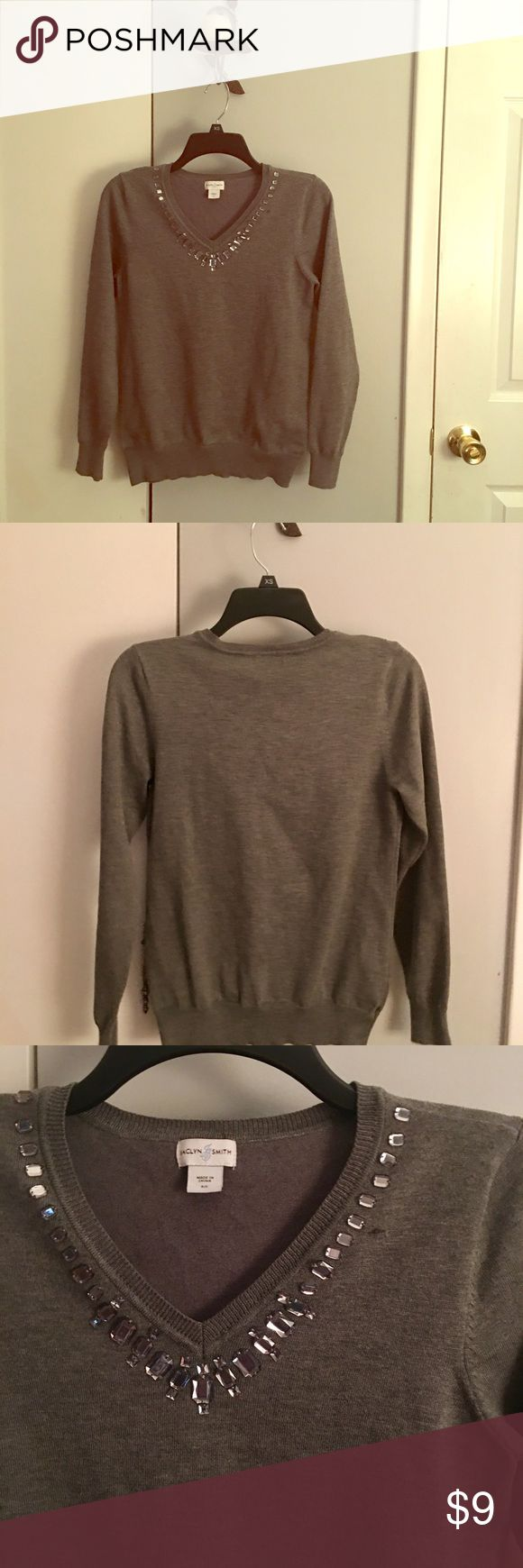 Gray EUC v neck sweater with jewel embellishments Size Small - Jaclyn Smith / worn only once for a couple hours - in EXCELLENT condition . V neck with jewels embellished around neckline ( all intact - none loose)  Perfect for upcoming holidays too⭐️as always bundle three or more listings and save an automatic 20% off total at least✨🌸 Jackyn Smith Sweaters V-Necks