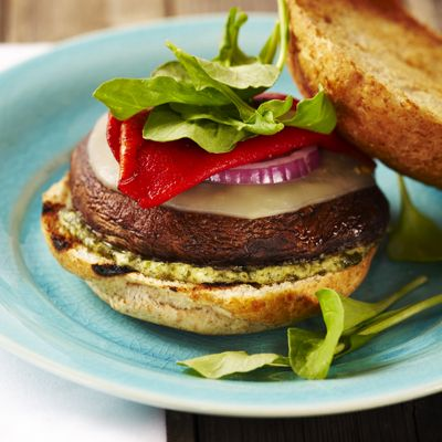 Grilled Portobello Burgers with Pesto Mayo | Meals.com Pesto Mayo adds delightful flavor dimension to these grilled portobello mushrooms. Slices of provolone cheese and red onions may be added along with the roasted red peppers to give extra flavor and color to these wonderfully delicious burgers. #Grill #GrilledPortobelloBurger #PestoMayo