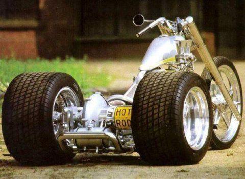Lowrider tike with HUGE rear wheels.