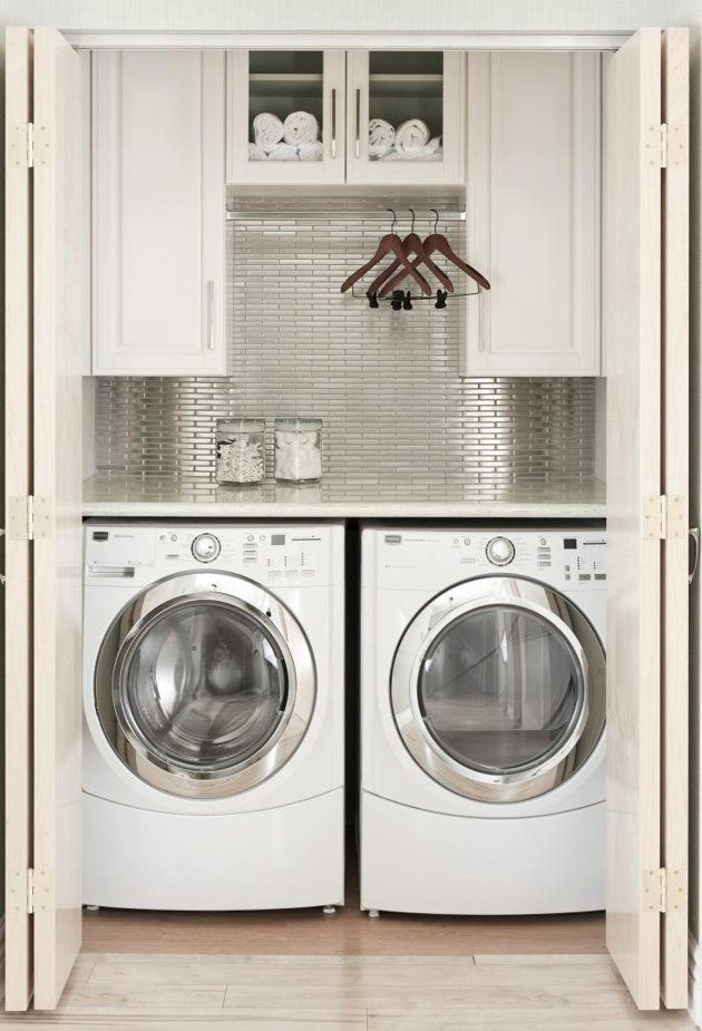 "I love these kinds of laundry ""rooms"" but I would make it a little wider to fit a cabinet between the machines, and I would opt for a top load washer.  Cause I'm old school like that."