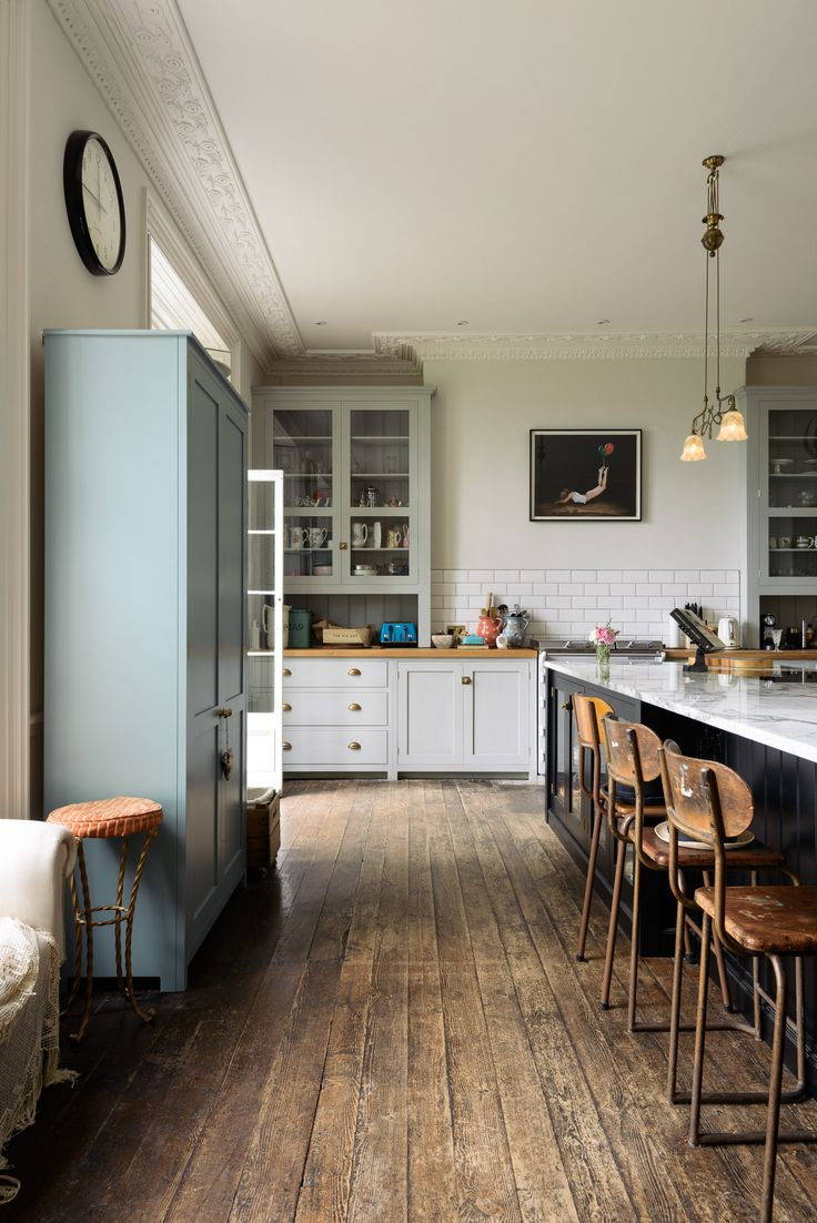 Original dark wooden floors and a beautiful mix of deVOL Classic English and Shaker kitchen furniture.