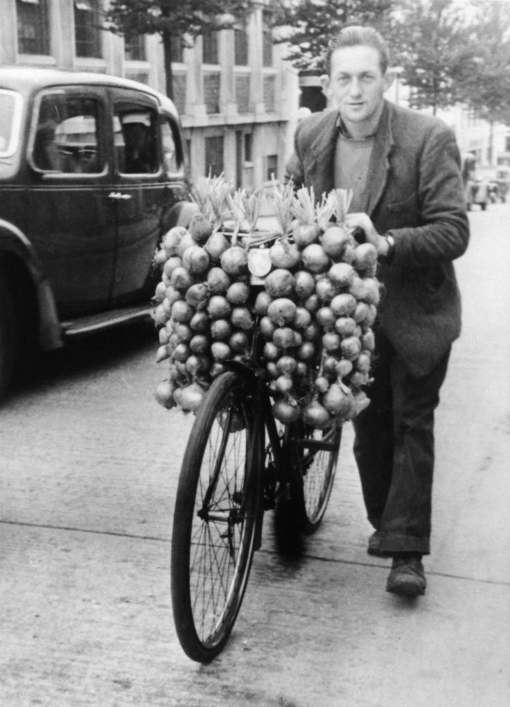 This black and white copy negative depicting an onion seller, with his bicycle. Is possibly in Glasgow in the 1940s to 1950s.