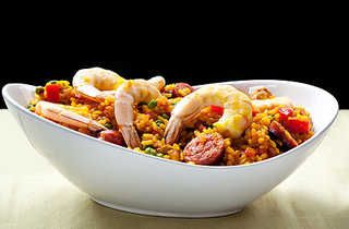 """""""paella"""" 70g chorizo, 1 bag of frozen prawns 1 red pepper, green pepper, 100g rice 1 can tinned tomato 1 tbs tomato puree 500ml boiling water   1 - fry the chopped chorizo in the pot for 3 minutes   2 - throw in the peppers for 1 minute   3 - add the boiling water, rice and tomato puree, mix around a bit, then cover the pot with a lid and leave to simmer on a medium heat for 13 minutes - giving it a stir every now and again.  4- fling in the prawns for the final 3 minutes   5- nom-nom-nom"""