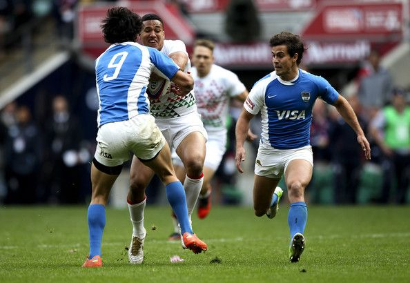 Marcus Watson of England is tackled by Matias Moroni of Argentina during the Marriott London Sevens - Day One at Twickenham on May 11, 2013 in London, England.
