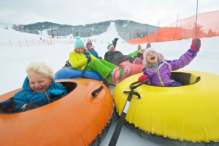 Slide into family fun at King Tubes at Snow King Mountain - the only snow tubing in Jackson Hole! Day and night. | 307-201-KING | info@snowkingmountain.com