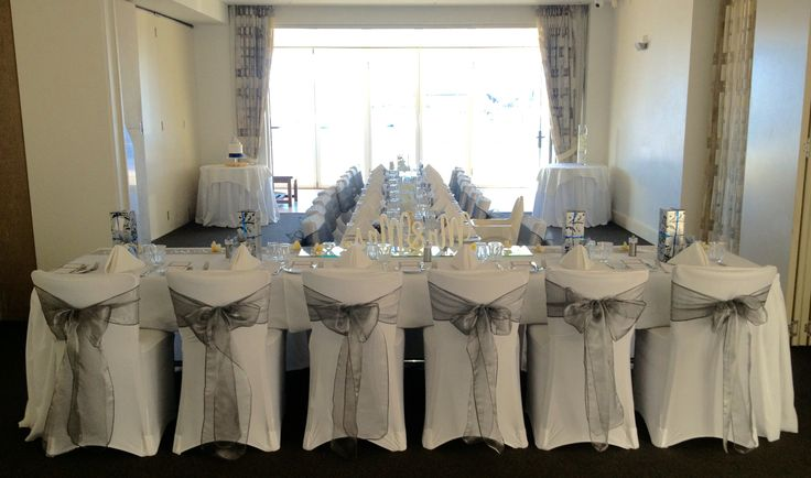 Small intimate wedding breakfast. Silver and white with Frangipani, lovely.