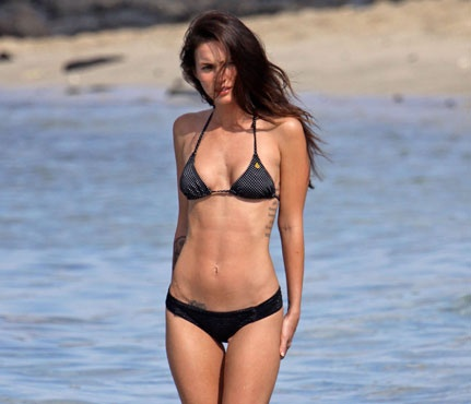 Megan Fox. Check out the definition in her abs....