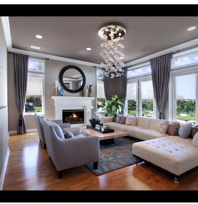 Neutral tone living room. Hard wood floors with fireplace