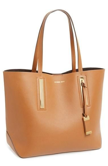 Sleek and simple for work or travel. Love this Michael Kors leather tote