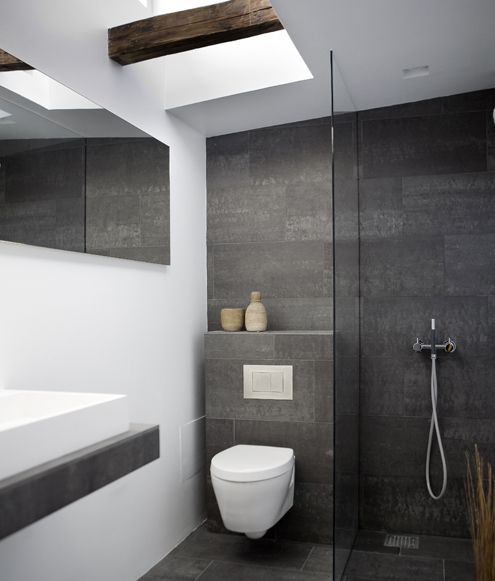 White and grey bathroom design with exposed beam