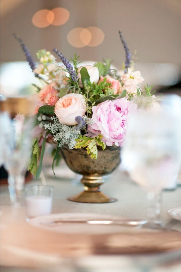 Garden roses, peonies, and beautiful coppery containers.