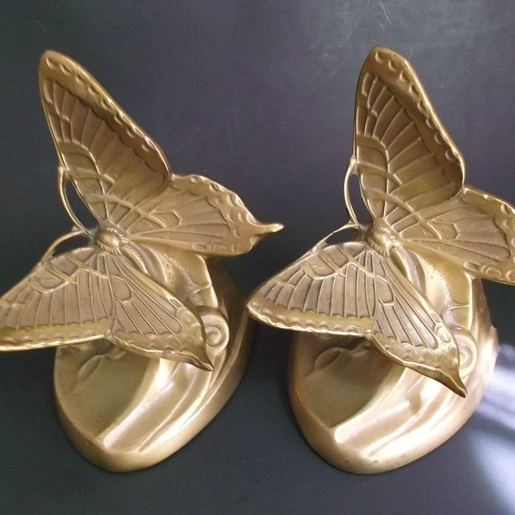 A pair of vintage PM Craftsman, art nouveau style, butterfly with morning glory, brass bookends. Still retain their original sticker on bottom.  At Saltymaggies Treasures on Ruby Lane