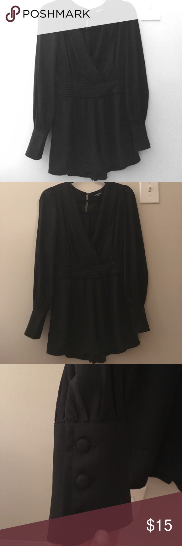 Black long sleeve romper Black long sleeve romper with button closure  at the top. Buttons on sleeves. Tobi Other
