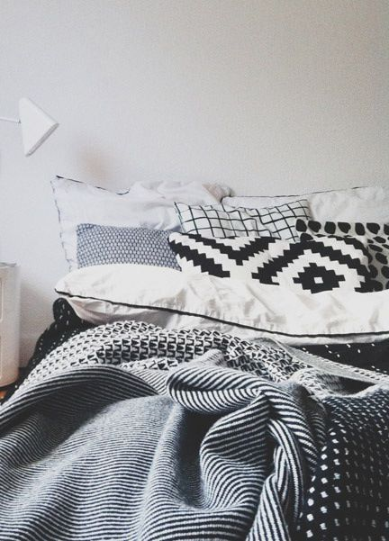 These bed linens are Aztec style patterns. By using just the colours black and white the textures are seen clearly for example the pillows squares stand out as the black colour is bold which makes it eye catching.