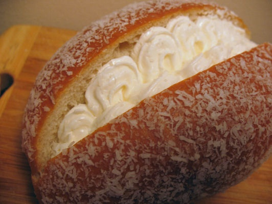 coconut cream bun- looks similar to cocktail buns, only it is laced with coconut and has a cream filling.