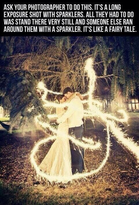 Ask your photographer to do this. They just stood there, still while someone ran around them with a sparkler