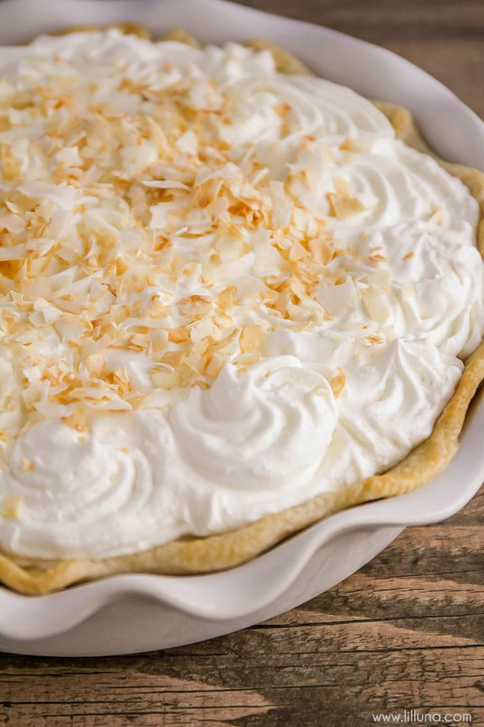 A delicious recipe for Coconut Cream Pie that has an amazing coconut pudding layer, cool whip layer and topped with toasted coconut shreds. { lilluna.com }