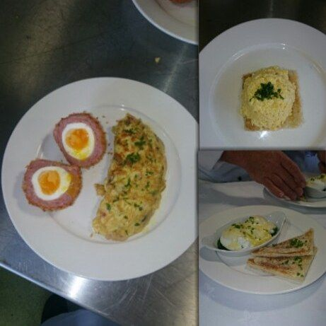 Selection of egg dishes; scotch egg, stuffed omelette with bacon lardons and spinach garnished with parsley,scrambled egg on crisp toast garnished with parsley and eggs benedict (bed of spinach with two soft poached eggs and a hollandaise sauce) with toast triangles and parsley