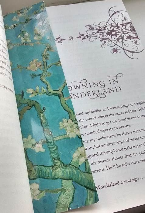 "paperbackphoenix: ""Books and Cupcakes Book Photo Challenge April 16th Flowers Unhinged by A.G. Howard. I don't have any flowery books so heres my Vincent Van Gogh Almond Blossom bookmark from Amsterdam. """