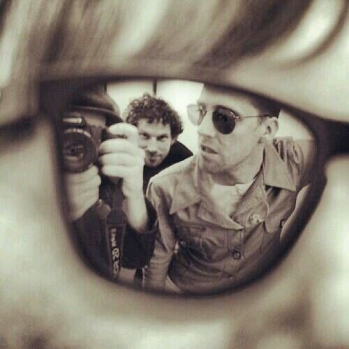 Peanut taking a photo of himself, Simon & Ricky in the reflection of Whitey's mirrored sunglasses: KAISER CHIEFS