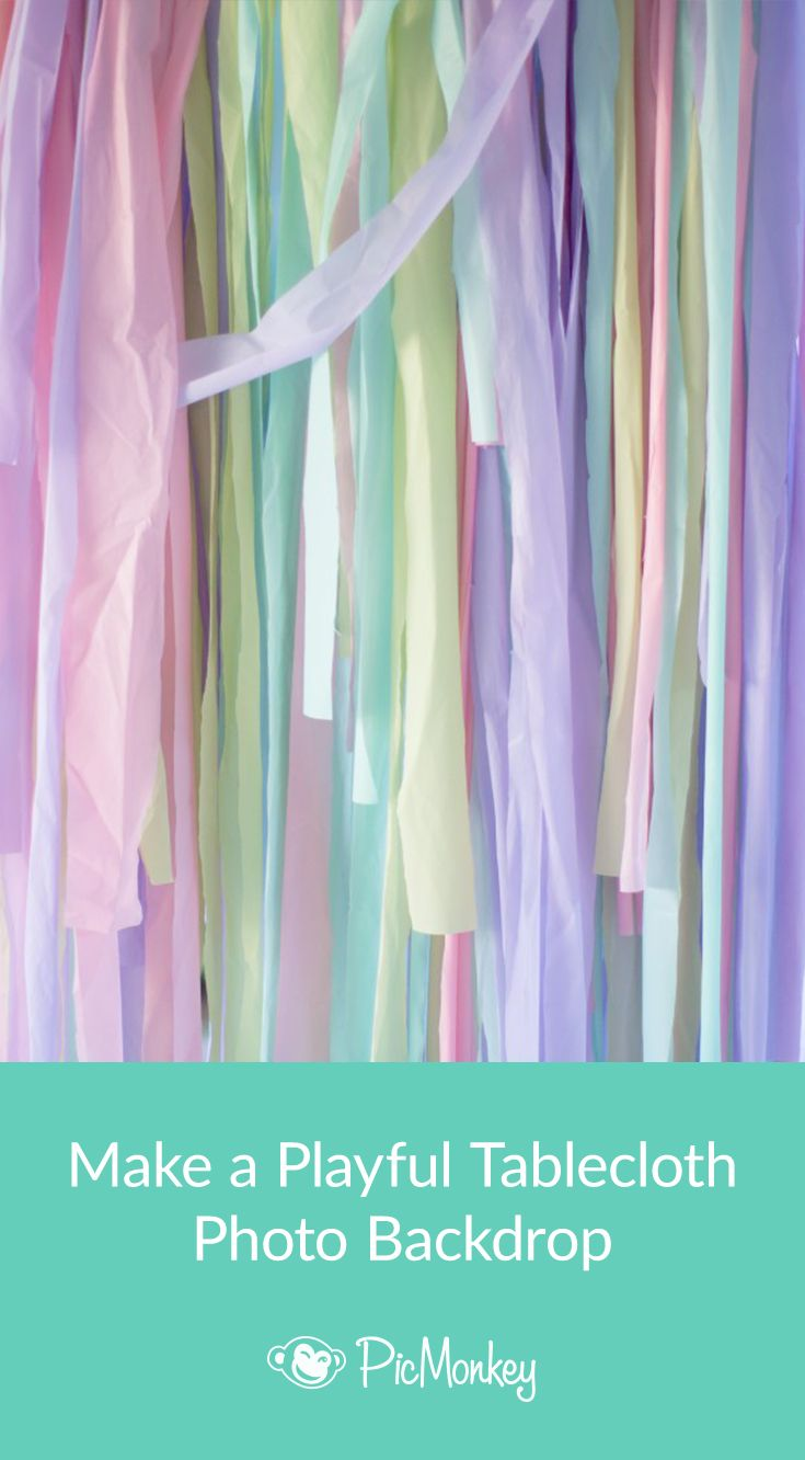 Make a whimsical photo backdrop out of inexpensive plastic tablecloths for your next party.