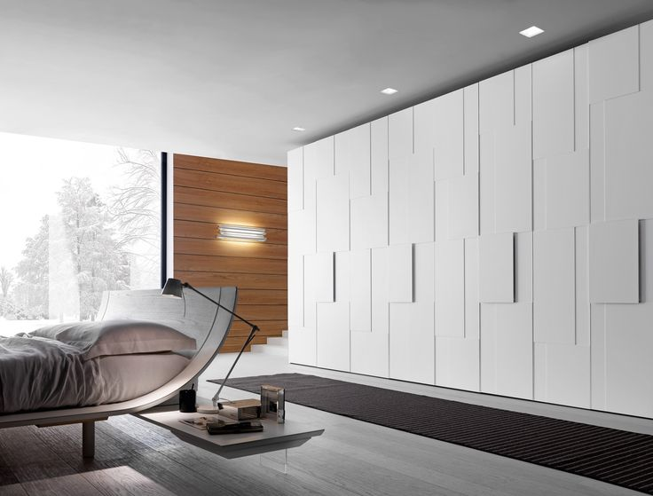 PRESOTTO | #Wardrobe with Step swing doors, the structural panel is in matt bianco candido lacquer with matt bianco candido lacquered panels applied to it and frames in a matching lacquered finish.__ #Armadio con anta battente Step, pannello strutturale laccato opaco bianco candido e pannelli applicati laccato opaco bianco candido con profilo laccato in tinta.