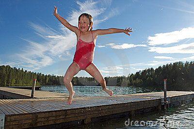 Little girl jumping in river