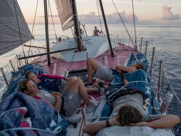 December 2, 2014. Leg 2 onboard Team SCA. Abby Ehler, LIbby Greenhalgh, Elodie Mettraux, and Stacey Jackson sit on the bow during sunrise. Corinna Halloran/Team SCA/Volvo Ocean Race