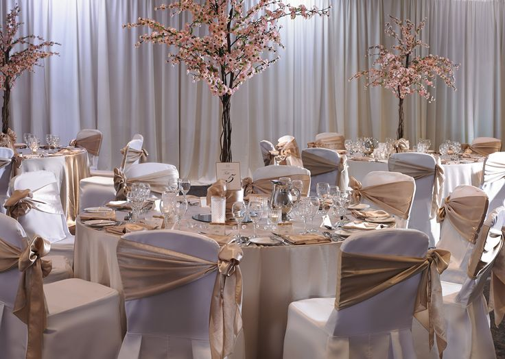 Spring Wedding Theme with cherry trees on tables