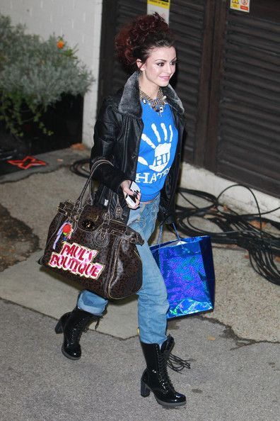 "Cher Lloyd Photos Photos - Cher Lloyd wears a 'Hi Haters' t-shirt as she leaves London's Fountain Studios after ""The X Factor"" results show. Over 28s' John Adeleye was the most recent contestant to be sent home. - Celebrities Leave Fountain Studios after Attending 'The X Factor' Results Show"