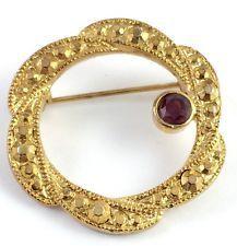Vintage Gold Tone Red Rhinestone Circle Pin Brooch Jewelry Filigree http://www.ebay.com/itm/Vintage-Gold-Tone-Red-Rhinestone-Circle-Pin-Brooch-Jewelry-Filigree-/141612492580?pt=LH_DefaultDomain_0&hash=item20f8c32724
