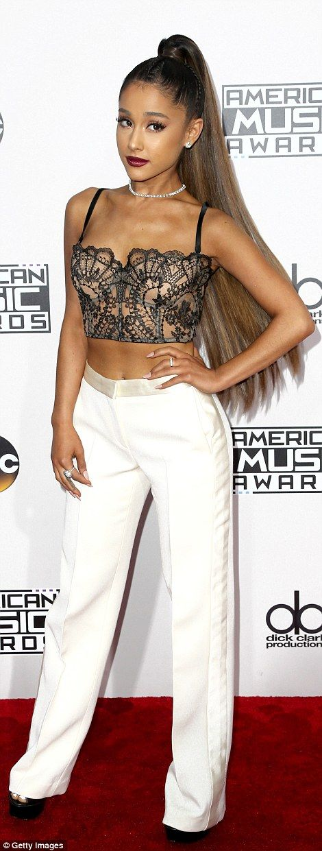 Popstrel: Ariana Grande teamed some  Alexander McQueen trousers with a sexy vintage lace crop top and her signature hairdo