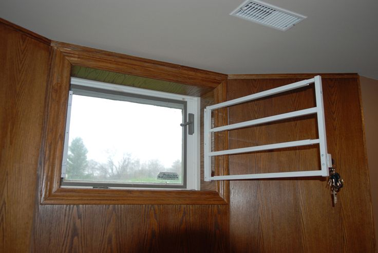 Hinged Removable Bar - Hinged - basement window bar 1 - Canada Window and Door Security