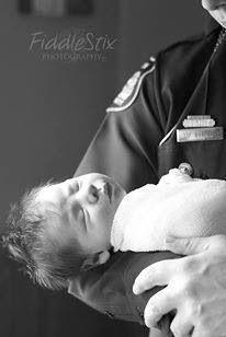 ideas for newborn pics- police baby!