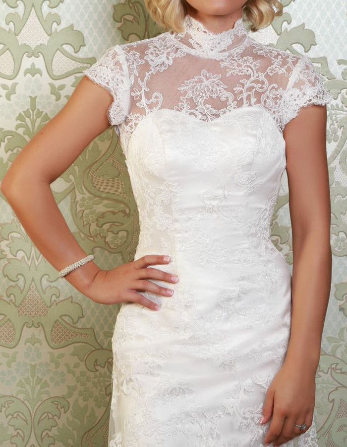 OBERON A stunning gown, the Oberon features a high neckline, a cut-out back and short sleeves, finished with scallop-edged lace. https://www.wed2b.co.uk/vintage-wedding-dresses/viva-bride-oberon.php